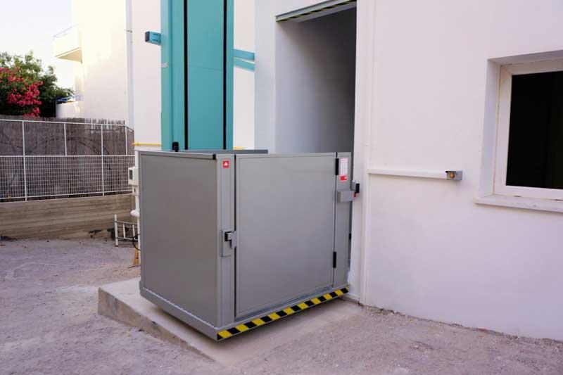 Κατακόρυφο σύστημα ανύψωσης AMEA Vertiplat με πόρτα
